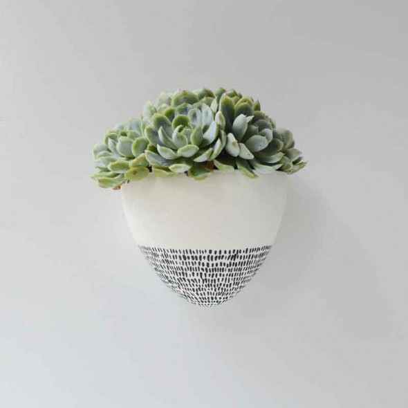 Renee boyd white wall planter with half black dashes situ1