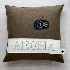 'Aroha tiki' trade cushion